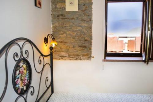 Vom Schlafzimmer des Bauernhofs Sardinien auf die herrliche Landschaft, bis hin zum Meer blicken
